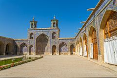 Nasir al-Mulk Mosque inner courtyard. Beautiful inner courtyard buildings with towers of the Nasir al-Mulk Mosque is a traditional mosque located in Goad-e Royalty Free Stock Image