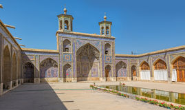 Nasir al-Mulk Mosque inner courtyard. Beautiful inner courtyard buildings with towers of the Nasir al-Mulk Mosque is a traditional mosque located in Goad-e Royalty Free Stock Photo