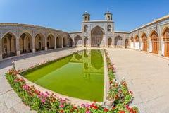 Nasir al-Mulk Mosque inner courtyard. SHIRAZ, IRAN - MAY 2, 2015: Visitors take a tour of the beautiful inner courtyard of the Nasir al-Mulk Mosque is a Royalty Free Stock Photos