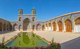 Nasir al-Mulk Mosque pond. Beautiful courtyard with pool of the Nasir al-Mulk Mosque is a traditional mosque located in Goad-e-Araban place in Shiraz Royalty Free Stock Photo