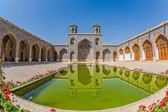 Nasir al-Mulk Mosque pond fisheye. Fisheye view of the beautiful courtyard with pool of the Nasir al-Mulk Mosque is a traditional mosque located in Goad-e-Araban Stock Image