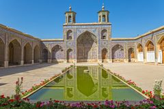 Nasir al-Mulk Mosque pool. Beautiful courtyard with pool of the Nasir al-Mulk Mosque is a traditional mosque located in Goad-e-Araban place in Shiraz Royalty Free Stock Photos
