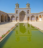Nasir al-Mulk Mosque pool. Beautiful courtyard with pool of the Nasir al-Mulk Mosque is a traditional mosque located in Goad-e-Araban place in Shiraz Royalty Free Stock Images