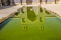 Nasir al-Mulk Mosque pool reflection. Beautiful courtyard with pool reflection of the Nasir al-Mulk Mosque is a traditional mosque located in Goad-e-Araban place Stock Image