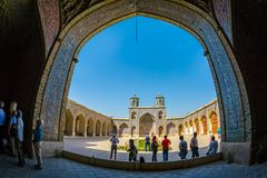 Nasir al-Mulk Mosque in Shiraz Arcade. SHIRAZ, IRAN - MAY 2, 2015: Visitors take a tour of the beautiful inner courtyard of the Nasir al-Mulk Mosque is a Stock Image