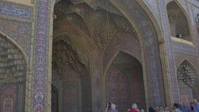 Nasir al-Mulk Mosque in Shiraz Arcade. SHIRAZ, IRAN - MAY 2, 2015: Visitors take a tour of the beautiful inner courtyard of the Nasir al-Mulk Mosque is a stock footage