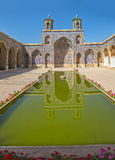 Nasir al-Mulk Mosque vertical. Beautiful courtyard with pool reflection of the Nasir al-Mulk Mosque is a traditional mosque located in Goad-e-Araban place in Royalty Free Stock Photo