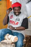 Portrait of a Bahamian carver smiling and working royalty free stock photography