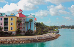 Nassau Bahamas Colorful Townhouses. Where the rich com to visit set against a bright blue cloud filled sky Stock Images