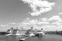Cruise ships in port of Nassau. Nassau, Bahamas-February 18, 2016: Large luxury cruise ships of Carnival, Norwegian and Royal Caribbean cruise lines docked in Royalty Free Stock Image