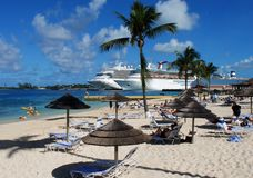 Nassau Beach. The view of Nassau town public beach with cruise liners in a background (The Bahamas Stock Photo