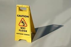 Nasse Fußbodenachtung Stockbilder