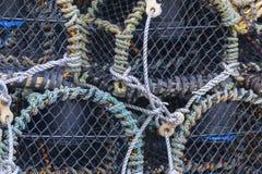 Nasse per crostacei impilate vicino su Immagini Stock