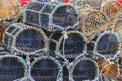 Nasse per crostacei impilate vicino su Fotografia Stock