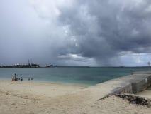 2017 Nassua Bahamas Beach Dark Wall Cloud. Rain port walkway stock photo
