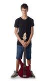 Nastolatek chłopiec z basową gitarą poważną zdjęcie royalty free