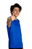 Nastolatek chłopiec trzyma jego aprobaty Obrazy Royalty Free