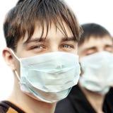 Nastolatek w grypy masce Zdjęcia Royalty Free