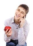Nastolatek z Apple i telefonem komórkowym zdjęcie royalty free