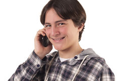 Nastoletni chłopak opowiada na telefon komórkowy Zdjęcie Royalty Free