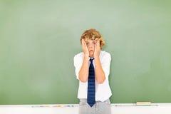 Nastoletni chłopak wprawiać w zakłopotanie Fotografia Stock