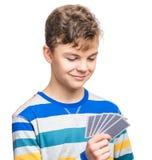 Nastoletnia chłopiec z hazard kartami obraz stock