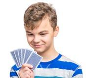 Nastoletnia chłopiec z hazard kartami zdjęcie royalty free