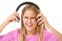 Nastoletnia dziewczyna krzyczy z hełmofonami odizolowywającymi zdjęcia royalty free
