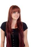 Nastoletnia dziewczyna patrzeje stronę ubierał w czerni z przebijaniem Zdjęcia Stock