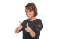 Nastoletnia dziewczyna pokazuje aprobaty i ono uśmiecha się Zdjęcie Stock