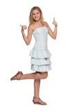 Nastoletnia dziewczyna z jej aprobatami Zdjęcie Stock