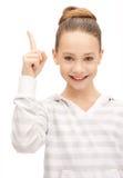 Nastoletnia dziewczyna z jej palcem up Fotografia Stock