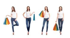 Nastoletnie dziewczyny z torba na zakupy na bielu Obrazy Royalty Free