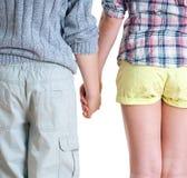 Nastoletniego chłopaka i dziewczyny mienia ręki. obraz stock
