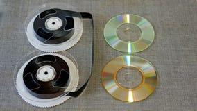 Nastri di VHS del film e dischi di CDR Immagini Stock Libere da Diritti