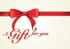 Nastri e cartolina d'auguri rossi, archi, contenitore di regalo Immagini Stock Libere da Diritti