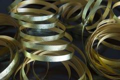 Nastri metallici dell'oro Fotografia Stock