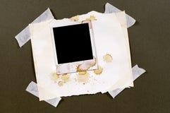 Nastro appiccicoso della struttura della stampa della foto dello spazio in bianco di stile della polaroid macchiato vecchia annat Fotografie Stock