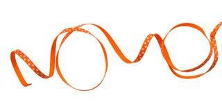Nastro arancione arricciato Fotografie Stock Libere da Diritti
