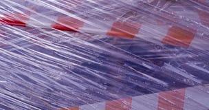 Nastro della costruzione coperto in plastica fondo, industriale fotografia stock libera da diritti