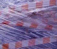 Nastro della costruzione coperto in plastica fondo, industriale immagini stock libere da diritti