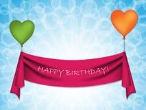 Nastro di buon compleanno sui palloni del cuore Fotografia Stock Libera da Diritti