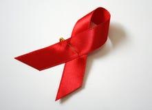 Nastro di colore rosso del AIDS Fotografia Stock