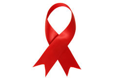 Nastro di colore rosso di consapevolezza del AIDS e del HIV Fotografia Stock Libera da Diritti