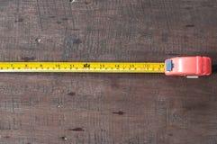 Nastro di misurazione a bordo Fotografie Stock Libere da Diritti