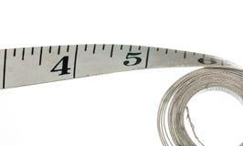 Nastro di misurazione del panno per la fabbricazione dei vestiti Immagini Stock Libere da Diritti