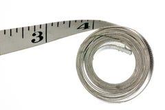 Nastro di misurazione del panno per la fabbricazione dei vestiti Fotografia Stock Libera da Diritti