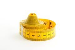 Nastro di misurazione giallo Fotografie Stock