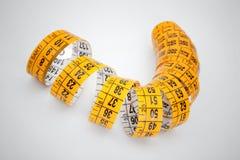 Nastro di misurazione giallo Fotografie Stock Libere da Diritti