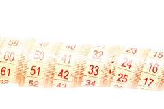 Nastro di misurazione rotolato di colore giallo Fotografie Stock Libere da Diritti